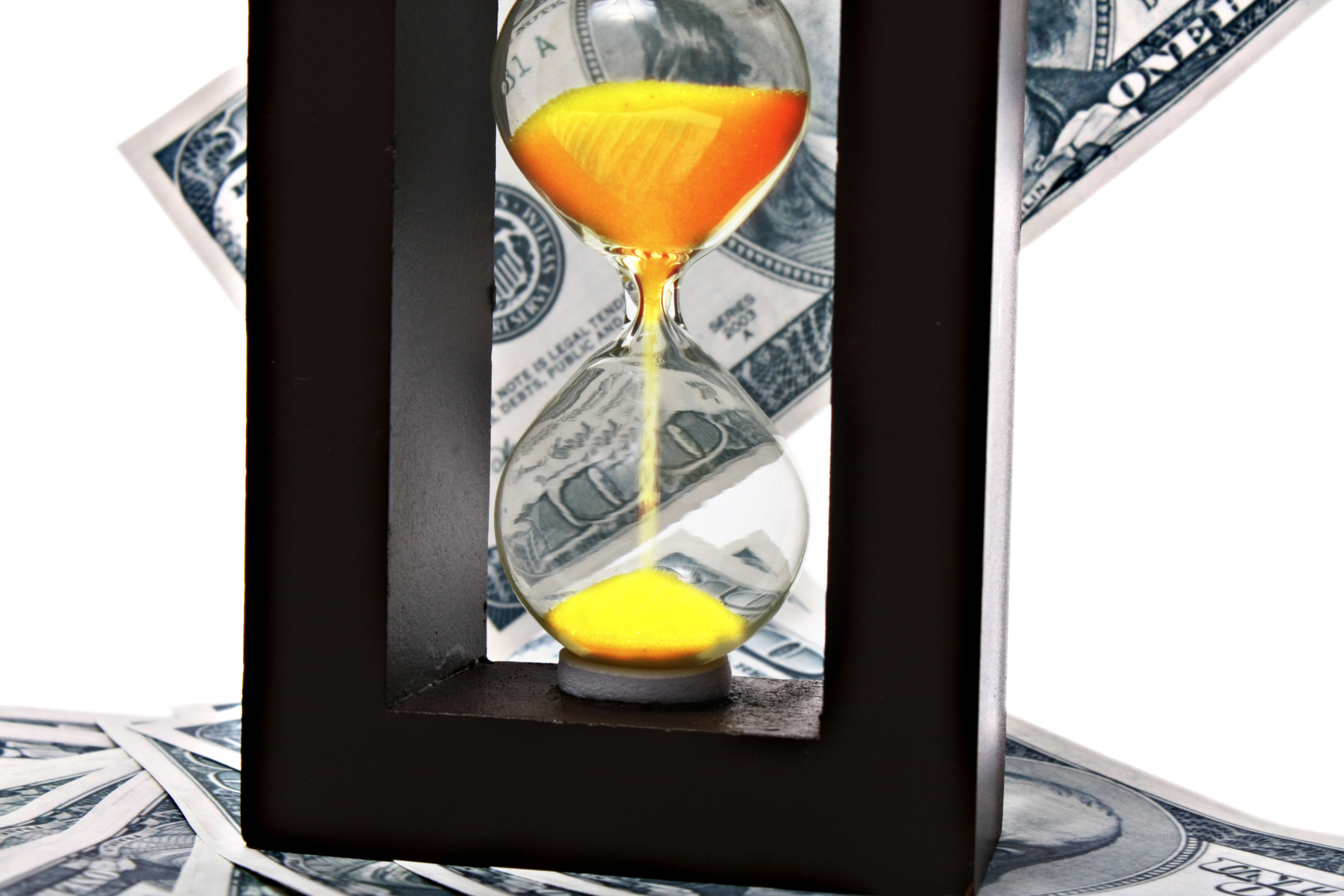 Sand clock with gold sand on dollar background