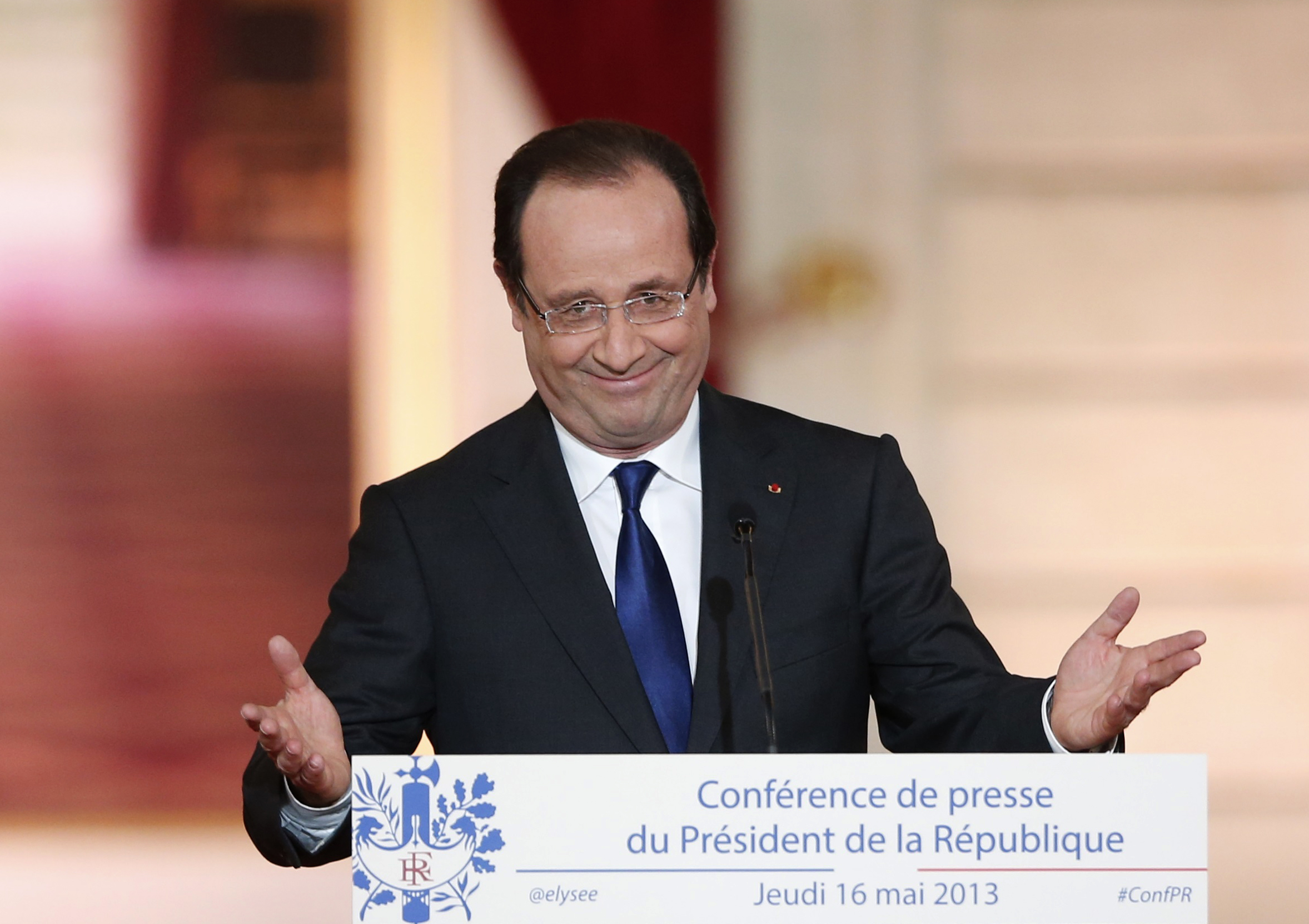 French President Hollande arrives to deliver a speech at the Elysee Palace in Paris