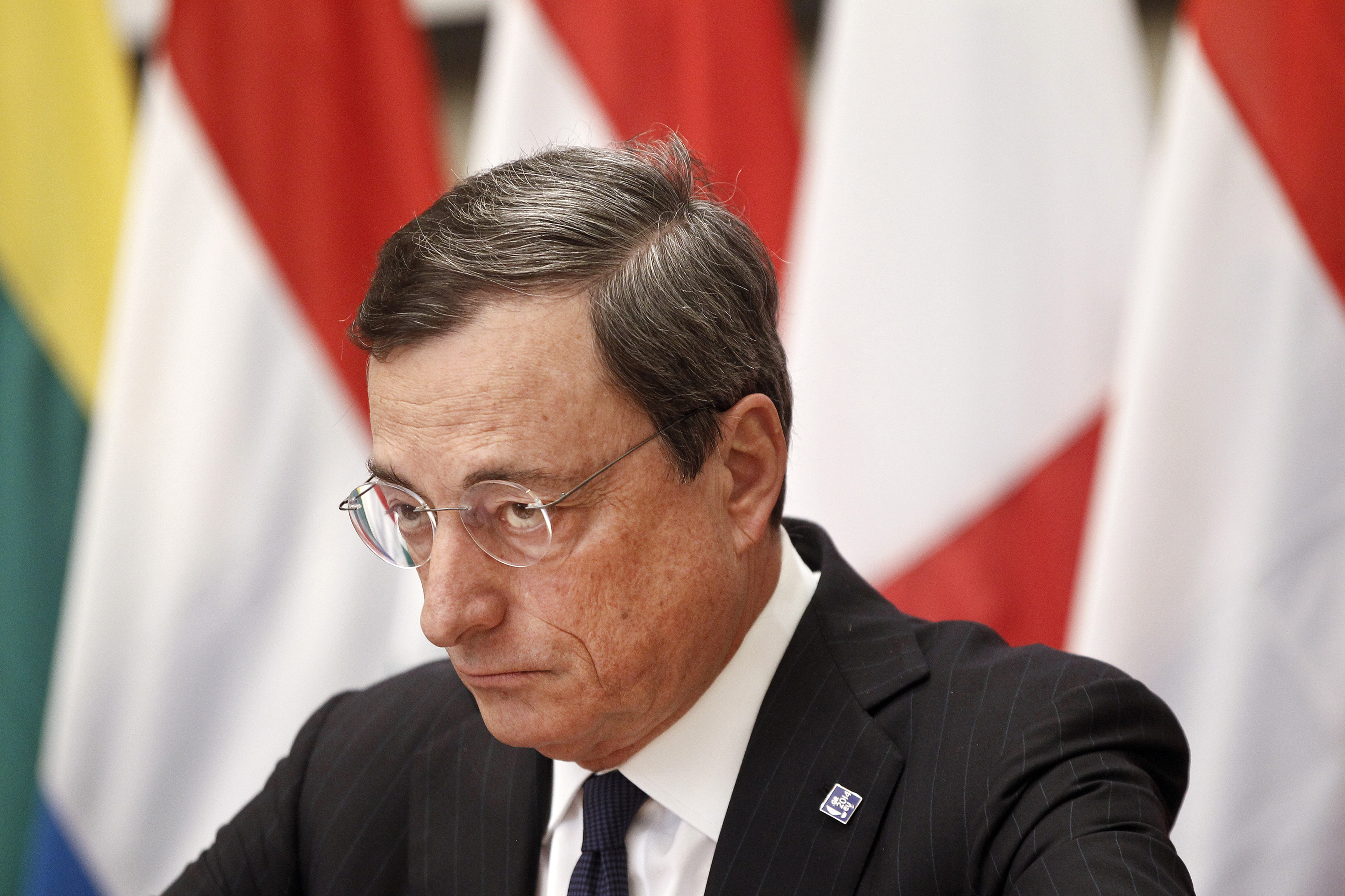European Central Bank (ECB) President Draghi attends a news conference during a European Union Finance Ministers informal meeting in Athens