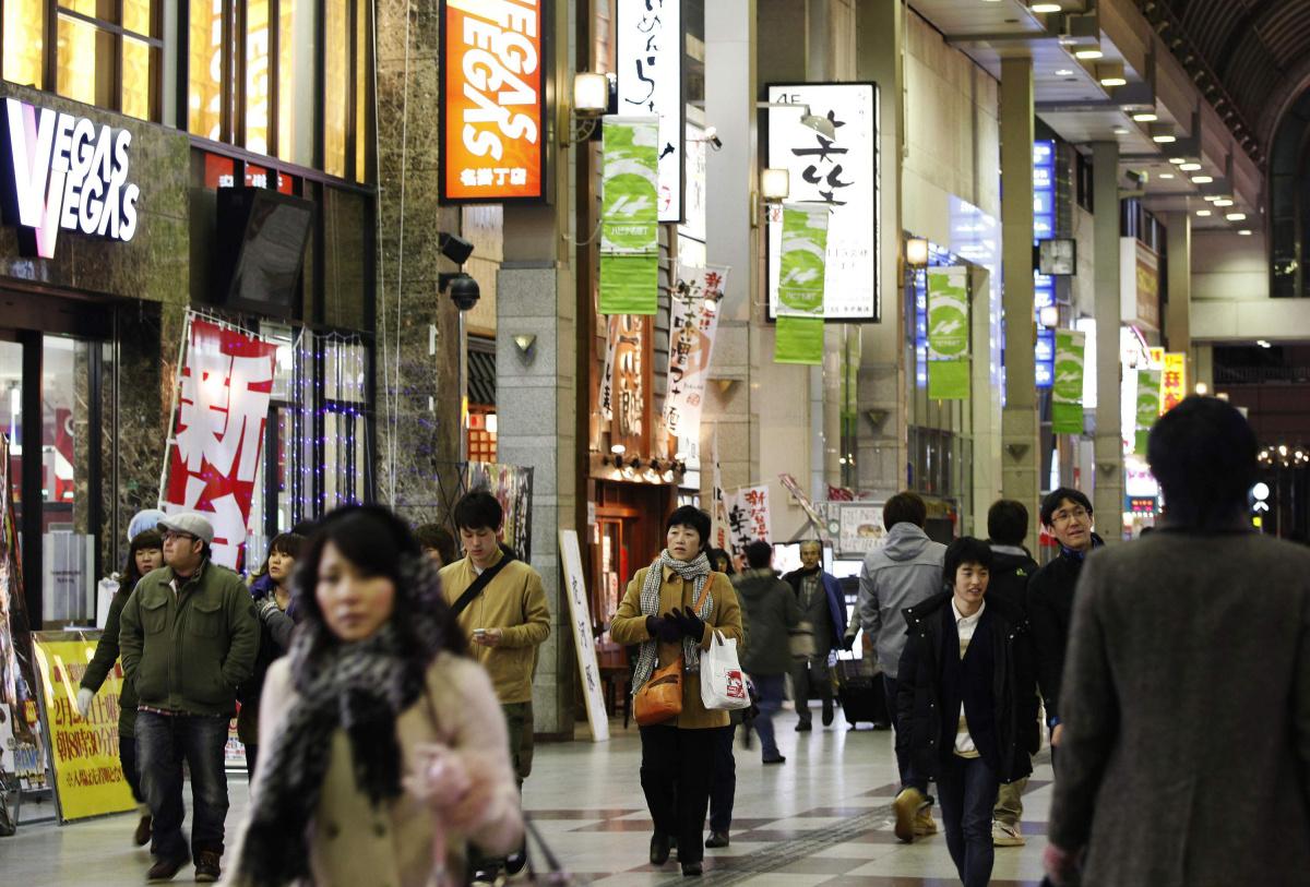 File photo of people making their way through a shopping arcade in Sendai