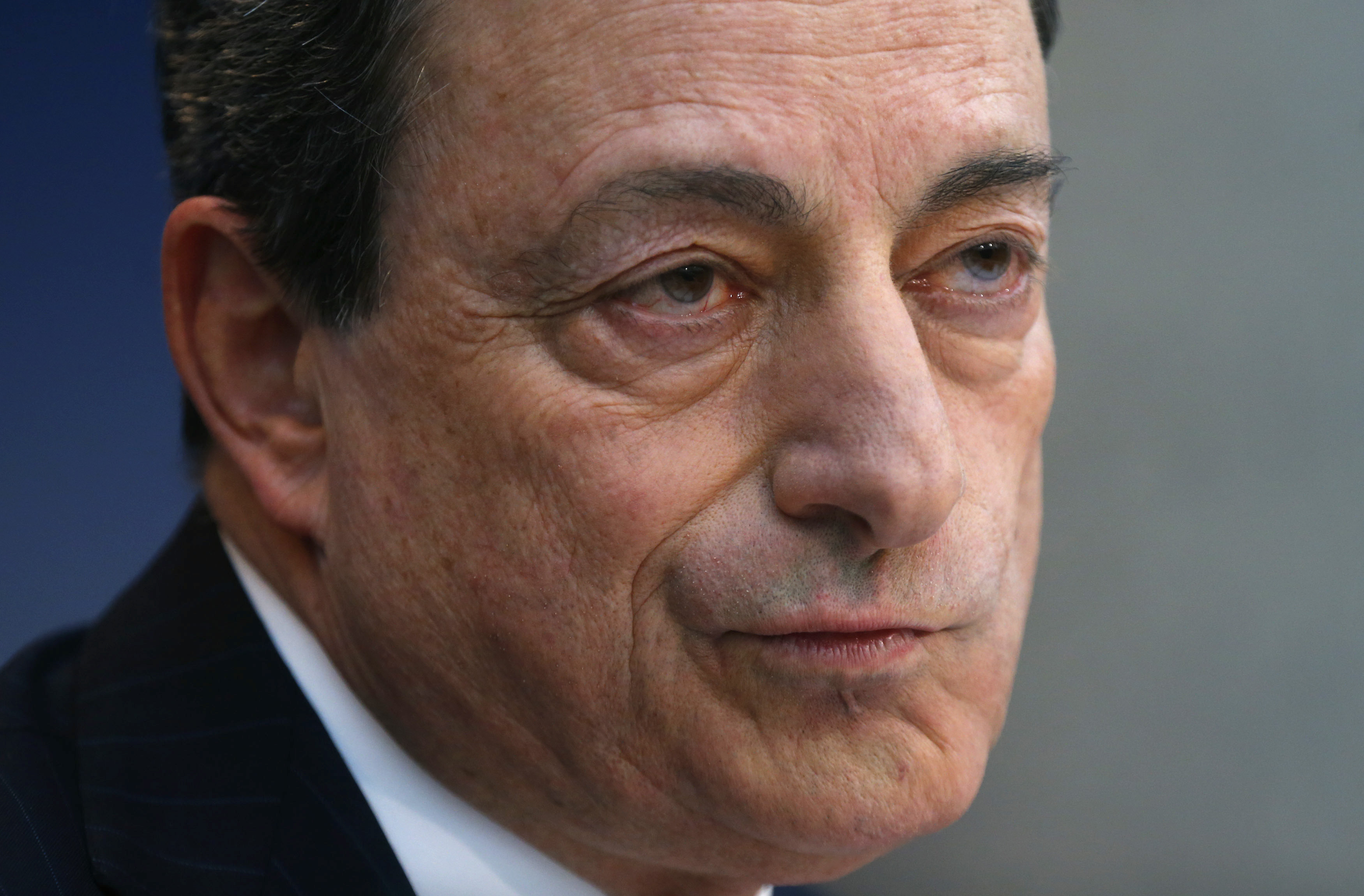 European Central Bank President Draghi frowns during the monthly ECB news conference in Frankfurt