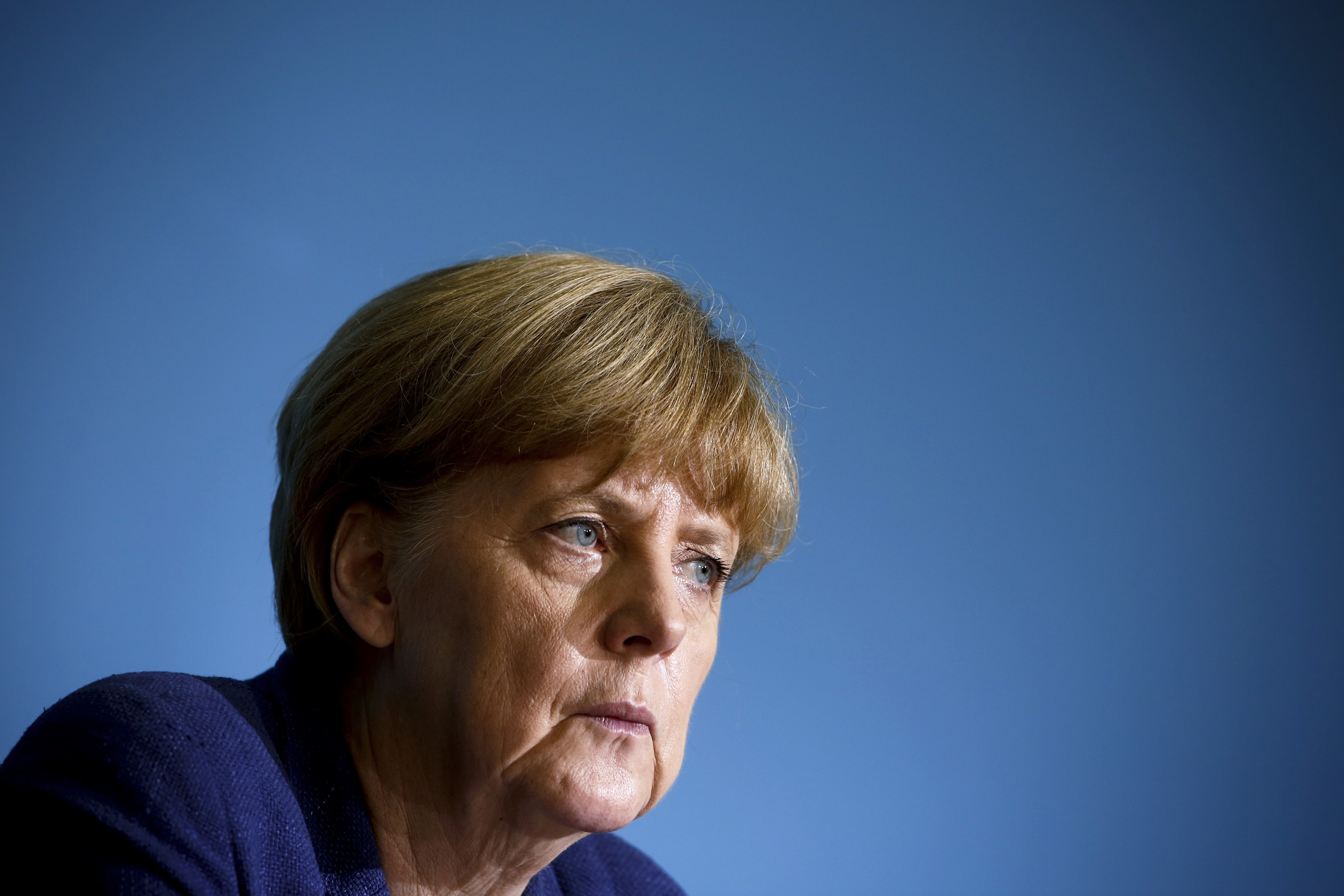 German Chancellor Angela Merkel attends a news conference after a meeting with East German state premiers in Berlin