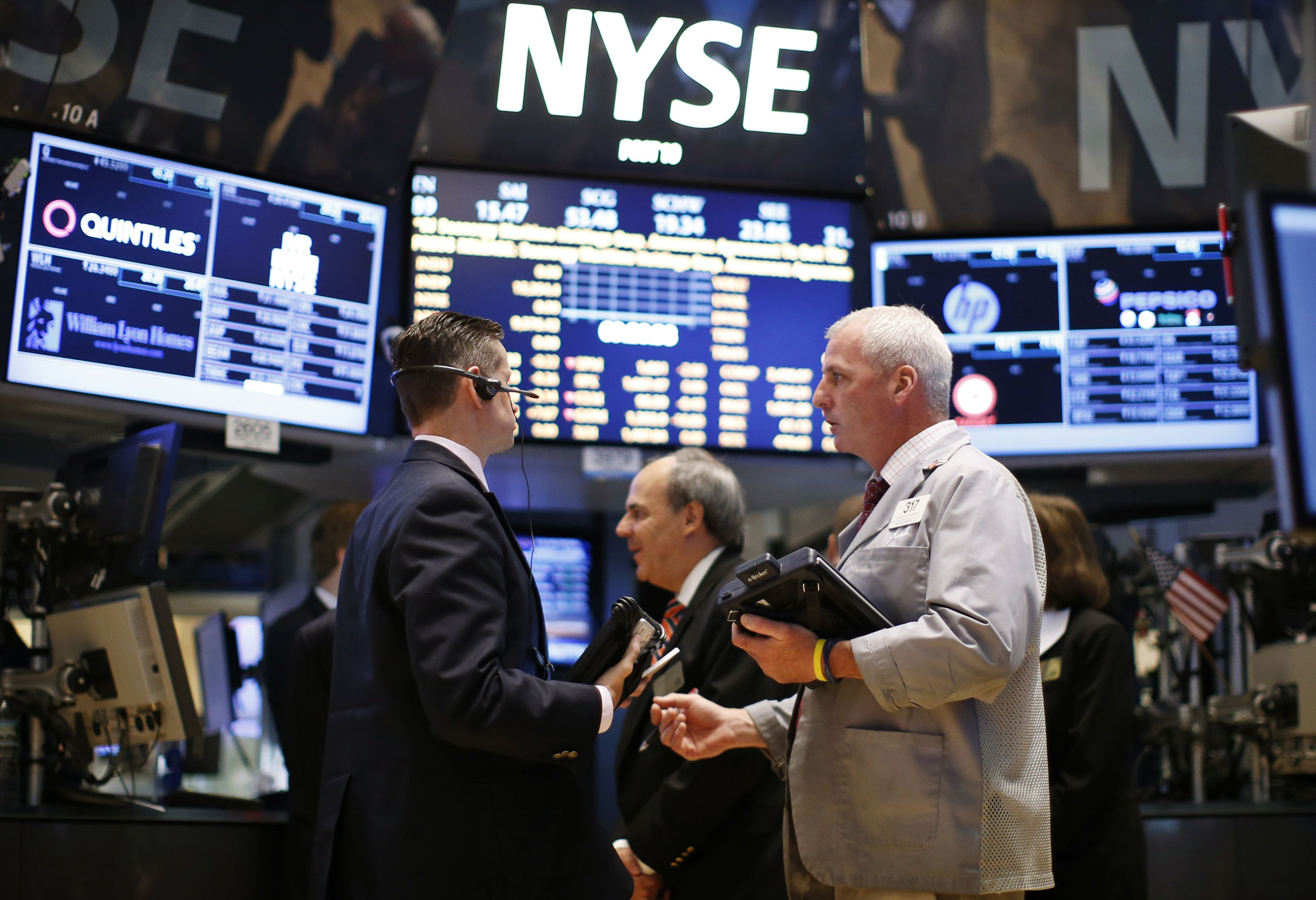 Traders work on the main trading floor of the New York Stock Exchange shortly after the opening bell in New York in this file photo