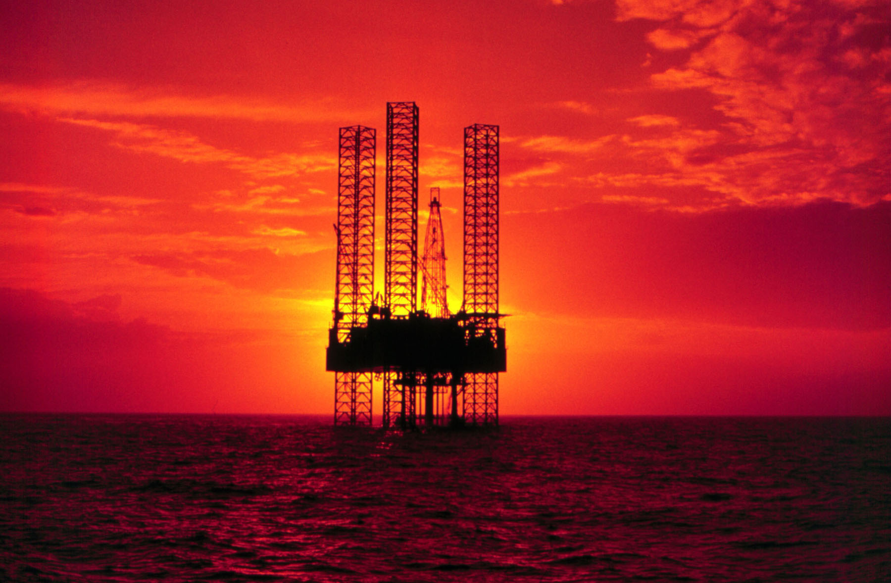 Pennzenergy Company Oil Exploration Drilling Rig In The Gulf Of Mexico During Sunset (Ph