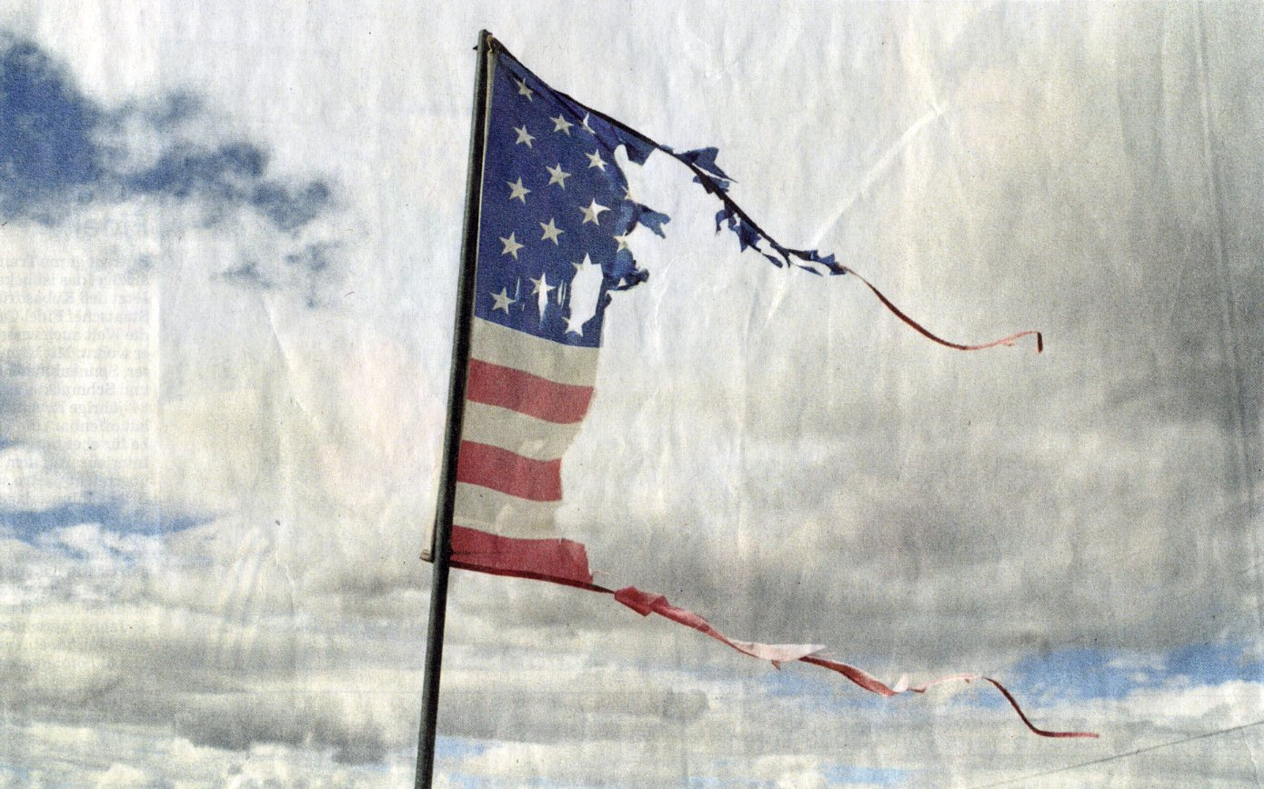 Anonymous - Torn US flag, 2010 - via Süddeutsche Zeitung