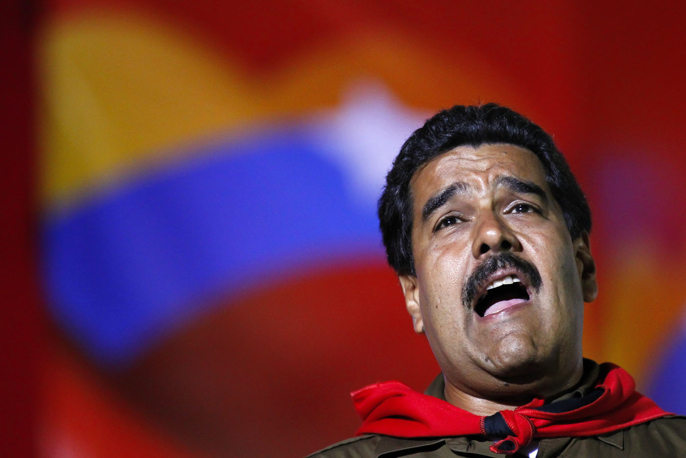 Venezuela's presidential candidate Nicolas Maduro sings during a campaign rally in Caracas