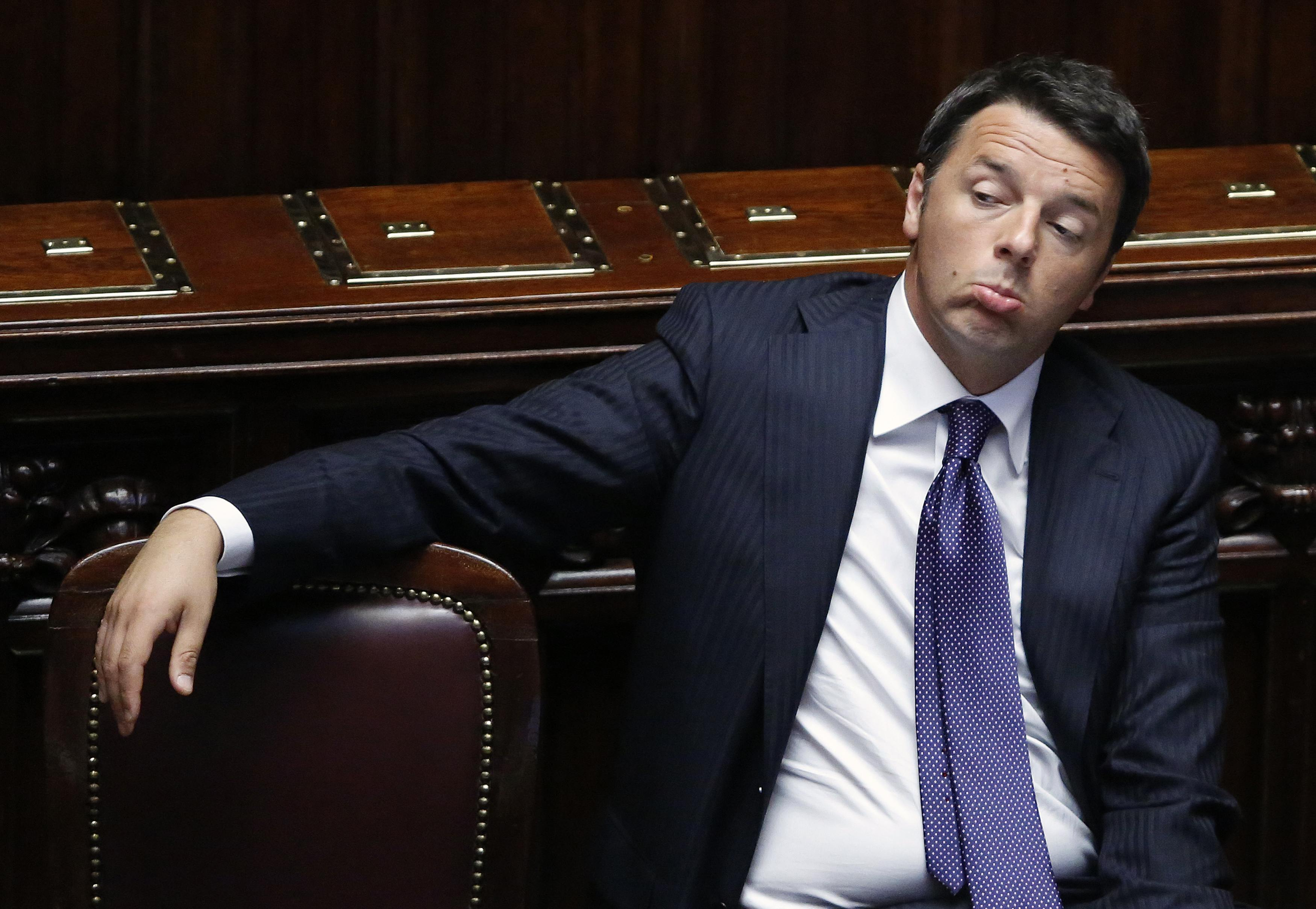 Italy's PM Renzi sits after delivering his speech at the Italian Parliament in Rome