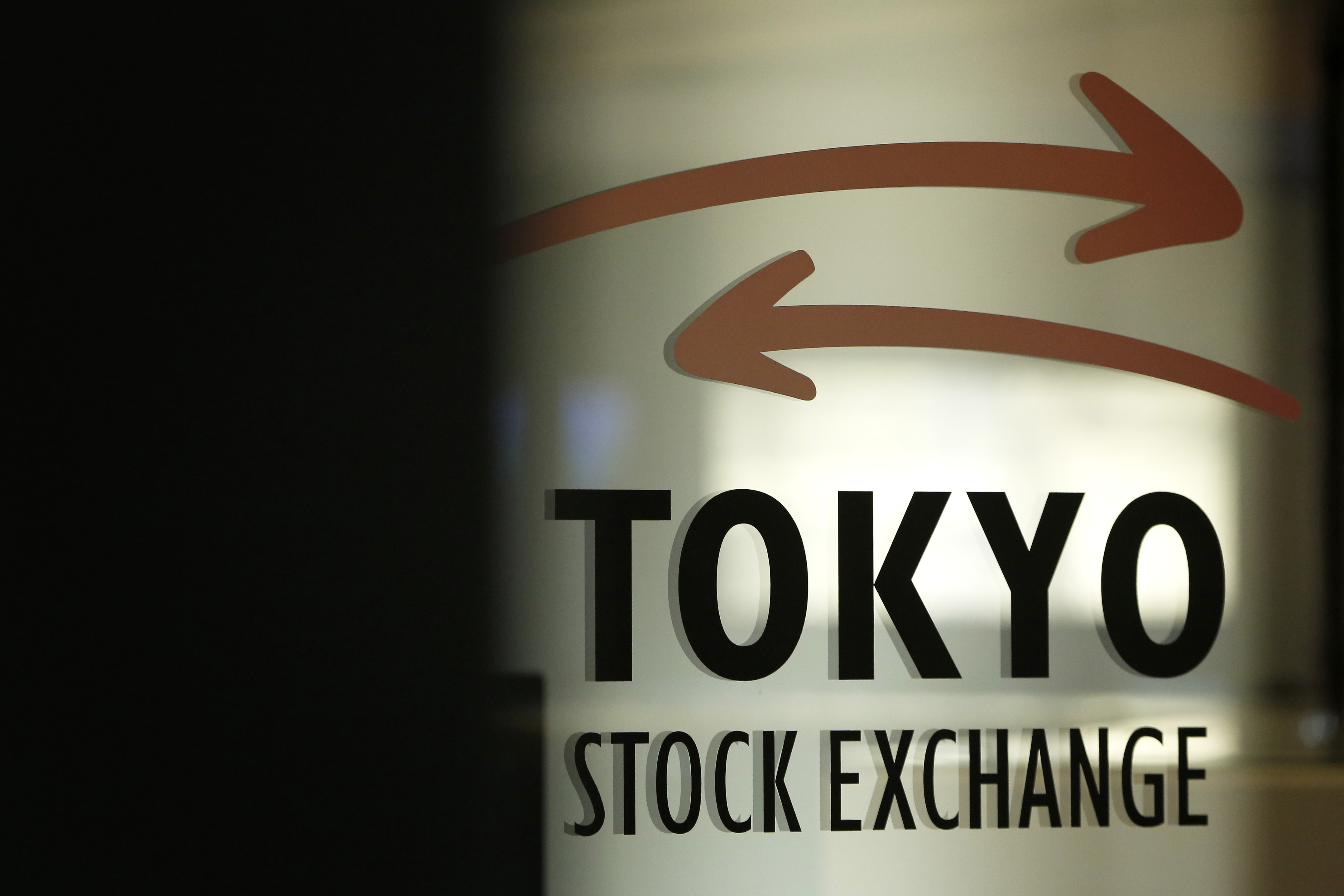 Commuters, Stock Exchange And Stock Boards As Asian Stocks Advance on U.S. Debt Accord