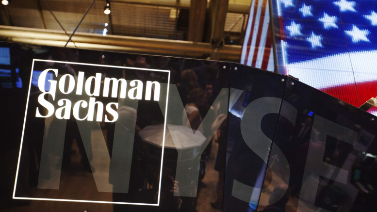 File photo of a Goldman Sachs logo displayed on a post above the floor of the New York Stock Exchange