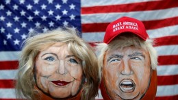 The images of U.S. Democratic presidential candidate Hillary Clinton and Republican Presidential candidate Donald Trump are seen painted on decorative pumpkins created by artist John Kettman in LaSalle