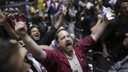 a-trader-signals-a-trade-in-the-sp-futures-pit-at-the-cme-group-in-chicago