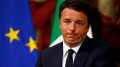 Italy Prime Minister Matteo Renzi makes a face as he talks during a news conference at Chigi Palace in Rome